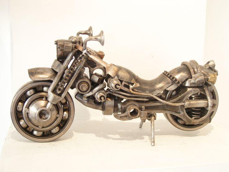 Metal motorbike sculpture created by visual artist Giannis Dendrinos. Metal engine parts and scrap metal.