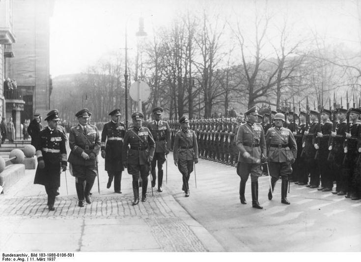 Werner von Blomberg inspects a parade in his honor on his birthday. Soldiers with Guns stand to attention.