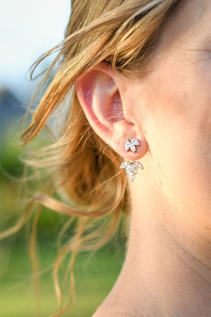 Silver and diamonds earrings for the bride on her wedding day in Fiji. Photo by Anais Photography.