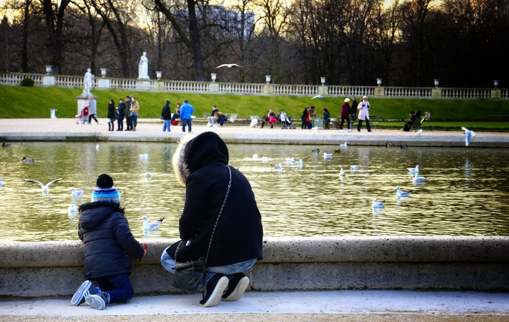 Luxembourg Gardens, Paris - a mum & son playing with the ducks