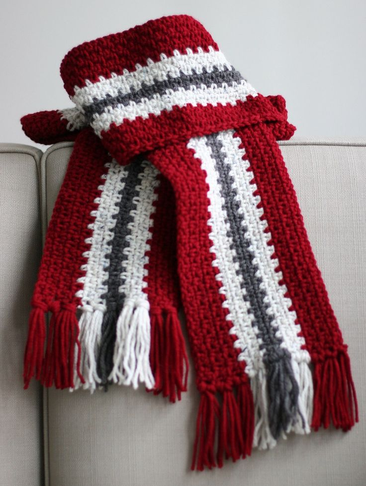Crocheted Men's Stripe Scarf ~ Make a Vertical Stripe Scarf using this free crochet scarf pattern. It's a unisex design so you can make it for any man or woman. Single crochet is alternated with a single chain making this an easy crochet scarf. Matching fringe added at the end gives this free crochet scarf pattern the perfect finishing touch.