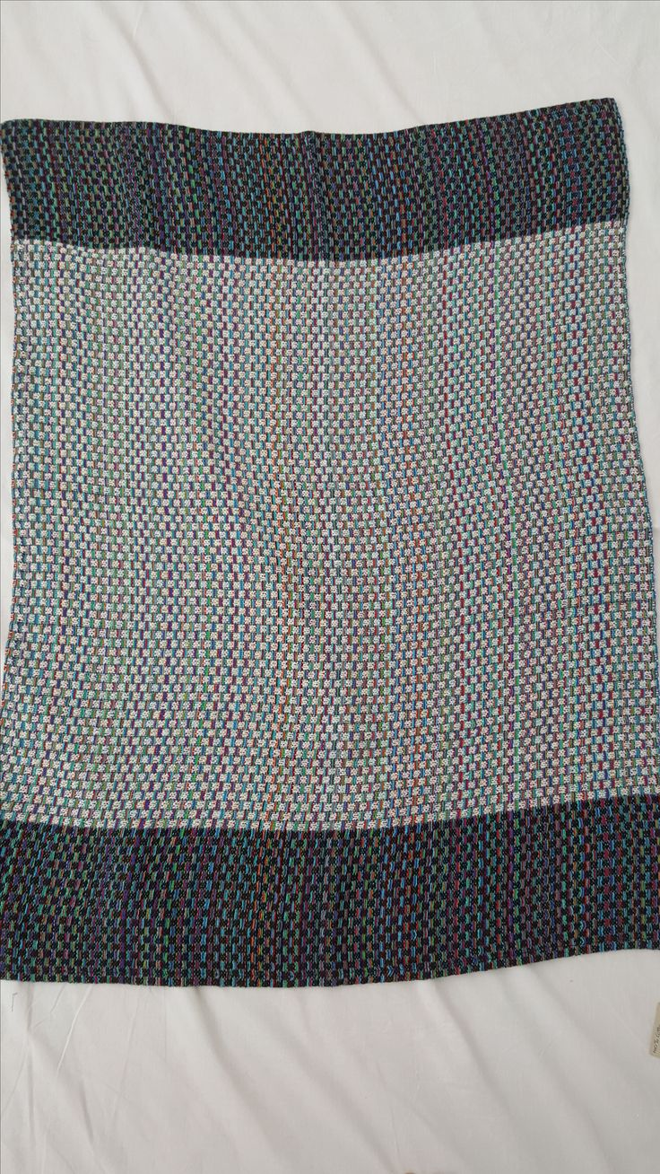 1090 - handwoven throw in black, unbleached cotton and multi colour ways.  Machine washable.  104 x 80 cms