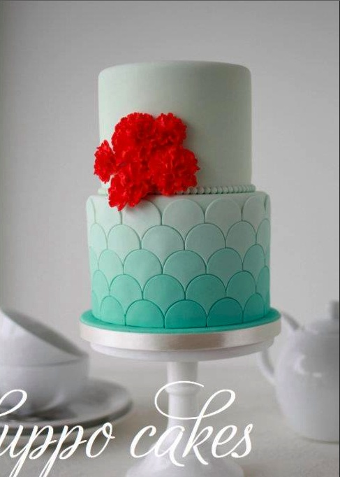 Scalloped Turquoise Ombre Wedding Cake With Red Flowers