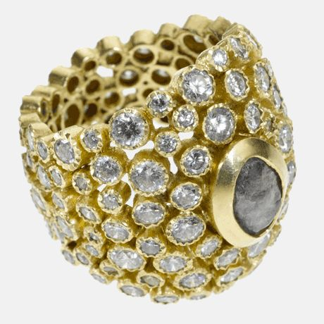 Todd Reed: 18ky gold ring with raw diamond center and white brilliant diamonds