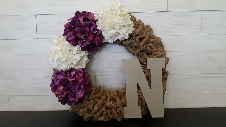 Burlap Wreath with Flowers and Monogram Letter . . #goldenforrest #goldenforrestcreations #burlap #burlapwreath #handmade #wreathideas #frontdoordecor #flowers #flowerwreath #monogram