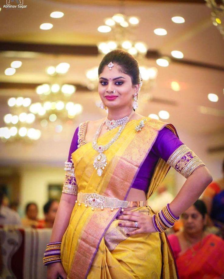 South Indian bride. Diamond Indian bridal jewelry.Temple jewelry. Jhumkis.Yellow silk kanchipuram sari with contrast purple blouse.Braid with fresh jasmine flowers. Tamil bride. Telugu bride. Kannada bride. Hindu bride. Malayalee bride.Kerala bride.South Indian wedding.