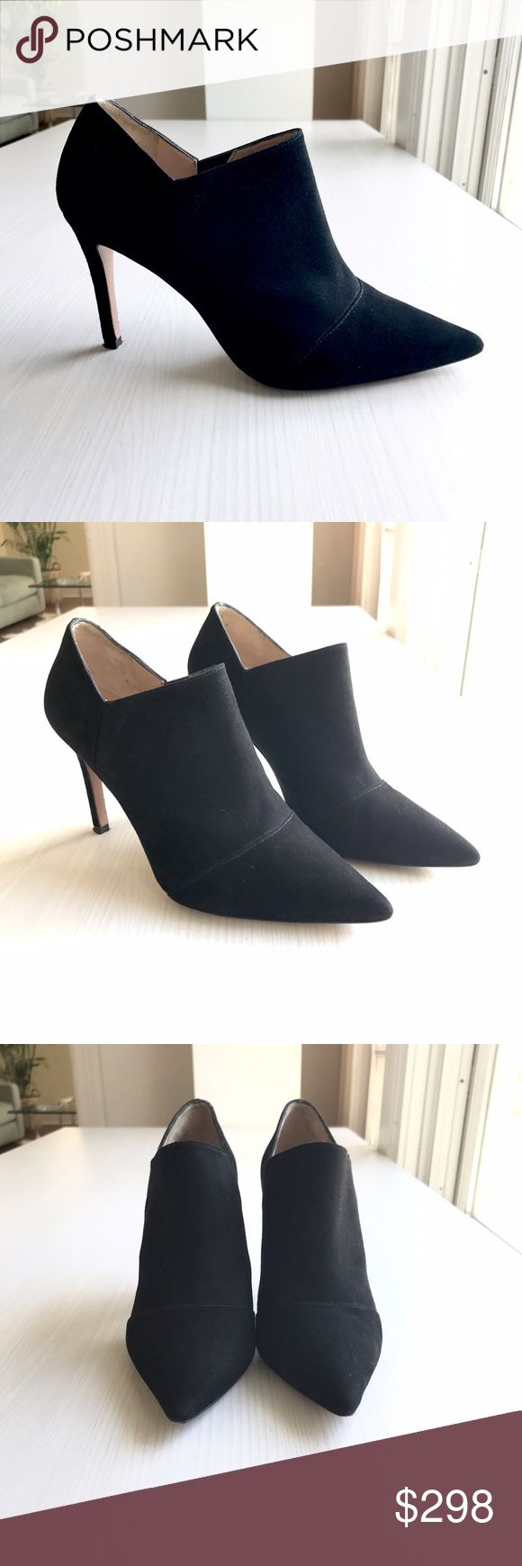 Pura Lopez Black Suede Booties Sleek black suede booties with sharp architectural lines and and sexy ankle cutout. 4 1/2 in. stiletto. Runs a smidge small - only worn once. Listing as a true size 8 (manufacturer says 8 1/2). Otherwise I love them - wish they fit me! Purchased at an upscale San Francisco boutique. Pura Lopez Shoes Ankle Boots & Booties