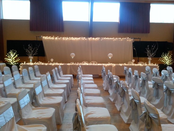 Beautifully lit head table and seating for 120 pp at wedding in the WA WA Shriners UPPER Hall.