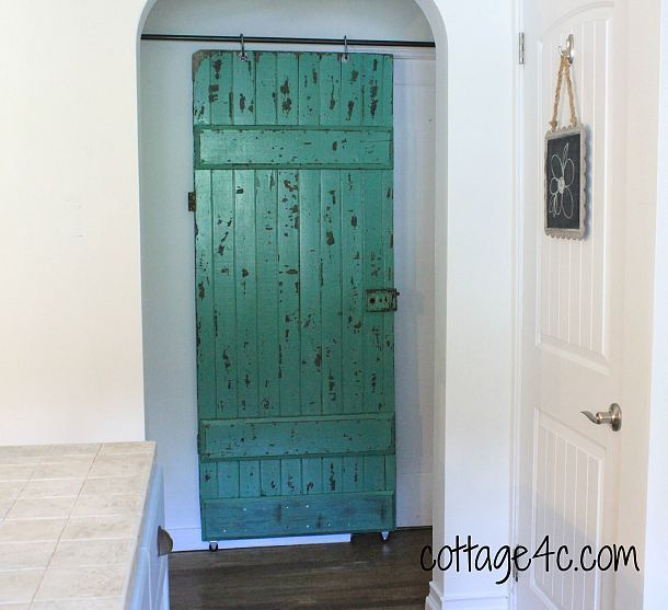 Use of an old barn door- from dining to playroom