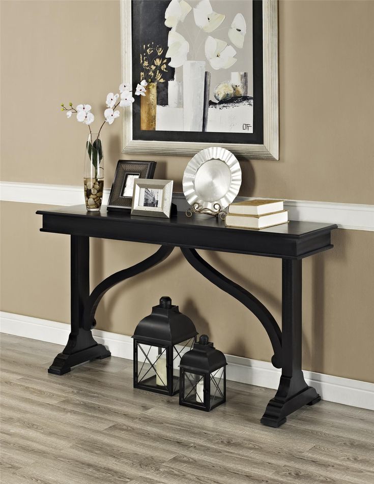 Make any room more elegant and inviting with the beautiful Altra Winston Wood Veneer Console Table. Place this Console Table up against a wall or behind a sofa to provide the perfect spot for an extra table lamp, home décor, laptop or family photos. You'll love the look of this Table in your home, no matter what the style of your interior. The distressed Black finish gives the Console Table a rustic, antique appearance and the look of a family heirloom. The graceful support frame between...