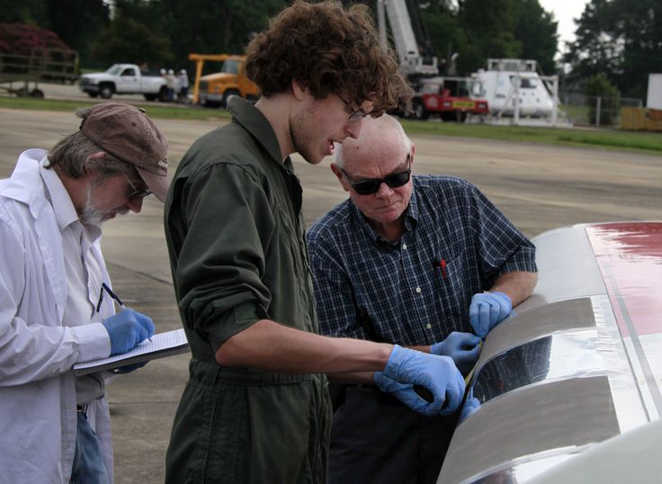 Researchers at NASA's Langley Research Center check results following preliminary NASA flight tests of nonstick coatings.