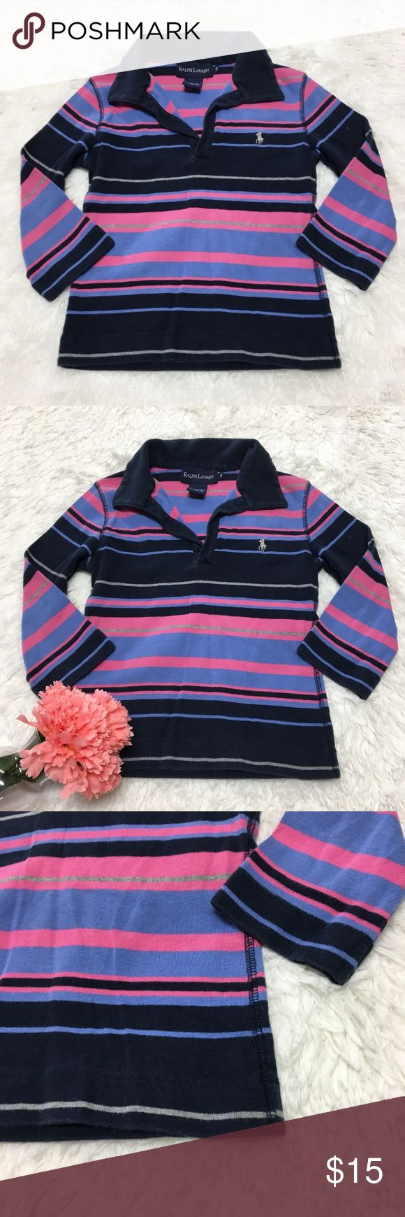 Ralph Lauren Stripe Rugby Collared Shirt 🔘Description: Ralph Lauren Stripe Rugby Collared Shirt girls size small 3/4in sleeve pink blue and navy blue ages 6/7 good used condition   🔘Measurements:   Pit to Pit: 13 inches               Shoulder to Hem: 16 inches                                                        Inventory: E   If you have any questions please feel free to let me know!                                Thanks for stopping by! Ralph Lauren Shirts & Tops
