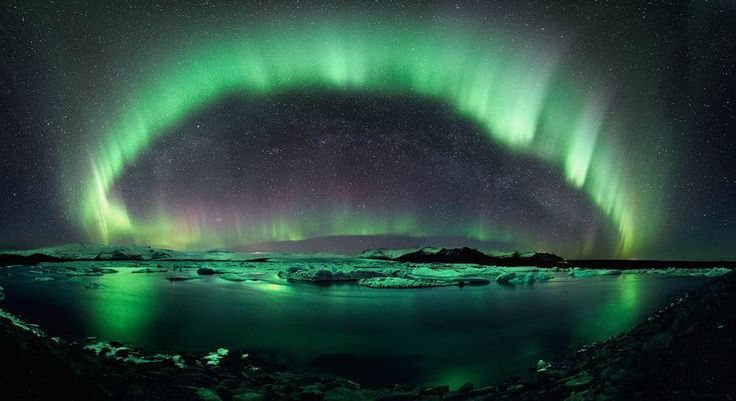 Stephane Vetter's award winning photo. Northern lights and the Milky Way above the Arctic landscape of Iceland.