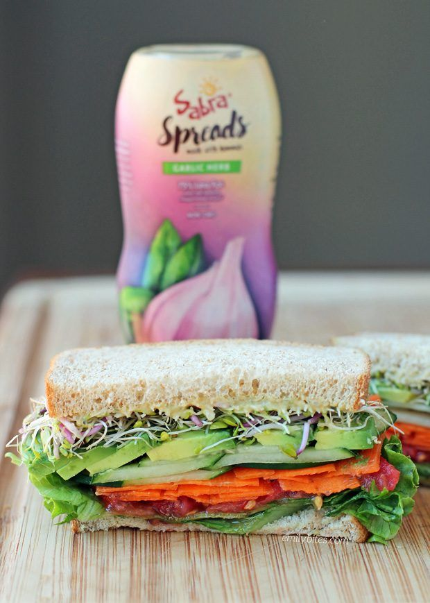 This Garlic Herb Veggie Sandwich has tons of fresh flavor with avocado, hummus spread and crisp veggies. Just 220 calories or 6 Weight Watchers SmartPoints! www.emilybites.com