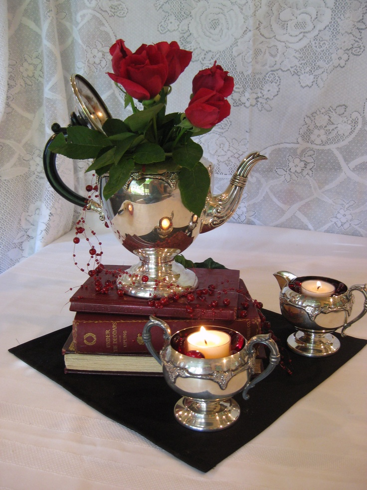 silver tea set, red books
