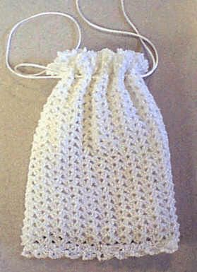 Our Free Bridal Shell Keepsake Pouch Pattern is perfect for the bride!  Enlarge the pattern for a purse - instructions included.  Or make one for each of the bridesmaids.  This pattern is versatile in that its just right for the prom to the evening out.   Work the pattern repeat, or simply repeat the shells!