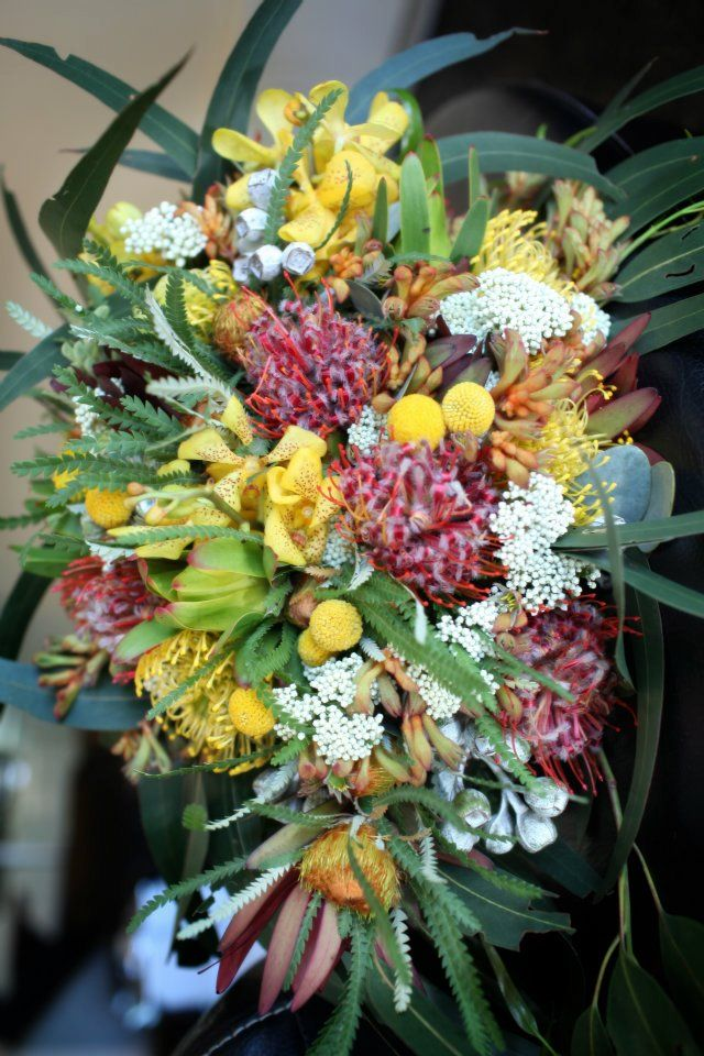 Beautiful trailing bouquet of assorted bush blooms - billy buttons leucadendron rice flower leucospernum and gum from the bush