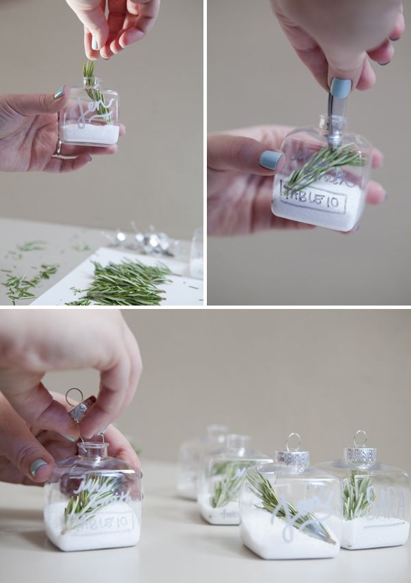 Simple DIY Wedding // christmas themed ornament escort or place cards! So easy... it's rock salt and rosemary! #somethingturquoise