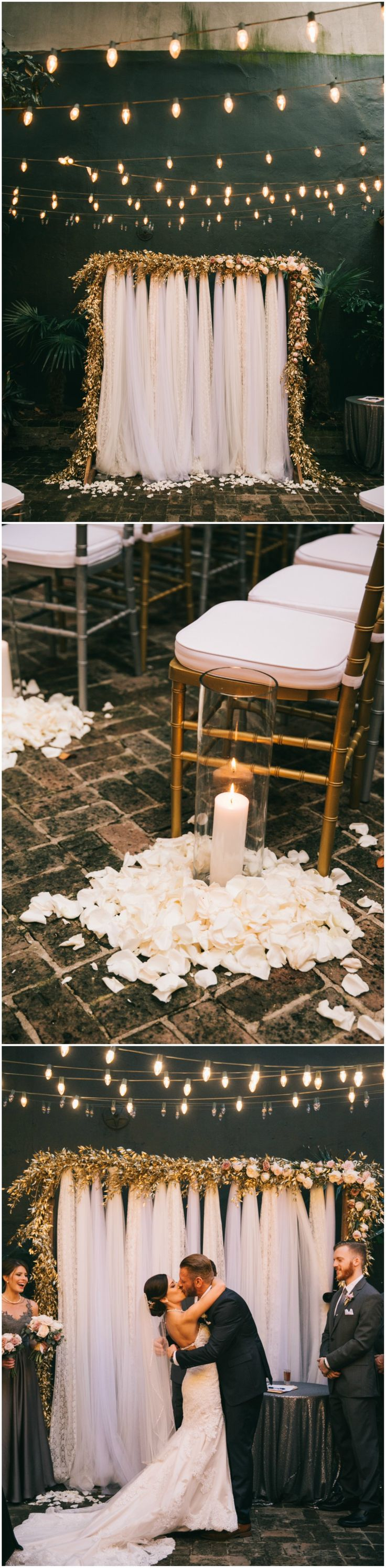 Romantic courtyard wedding ceremony, white petals on the floor, candles, wedding arbor, pink and white florals, white fabric, bistro lights, see the full wedding feature on borrowedandblue.com // Sarah Mattix Photography