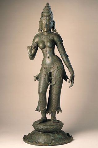 "#Parvati	  #India, Tamil Nadu; Chola period (880-1279), 11th century  Parvati, the daughter of the #Himalayan Mountains, is worshiped both as Shiva's wife and as an independent deity. She is identified by her conical crown with its mountainlike tiers and by the distinctive ""flower-holding"" gesture of her right hand. A statue of Parvati is an integral part of the imagery of #Shiva as Lord of the Dance."
