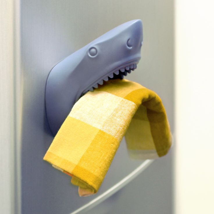 Our Shark! Shark! Wall Pocket is fresh off a feeding frenzy in the Carolinas and is coming to your town to help your clutter!  That's right, this land shark is not out for blood! They're ready to snack on your keys, accessories, neckties, money and more!  Place on doors and keep your most precious items in this shark's intimidating Jaws so that you don't forget anything on your way out.  This awesomely functional sculpture can be hung on walls with a hook.  It can also be attached onto…