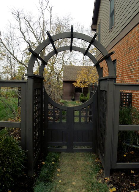 DIY gate for the yard! looks like the RL but better love everything about this. Looks like I could get salvage household doors knock panels out cut semicircle out.
