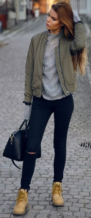 One of the most fashionable and casual outfits you could ever find. Combine high waisted jeans with a gray sweater and a green bomber jacket. Accessorize with booties and a black backack. Invest in the natural beauty look and manicure.