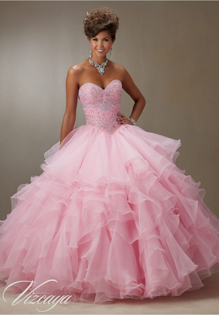 Quinceanera dresses by Vizcaya Sugar Coated Stones on Organza Ruffled Skirt Matching Bolero Jacket included.Colors: Light Aqua, Pink, Coral, White.