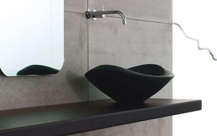 Черная раковина мойка из акрила и черная столешница. Дизайн из акрилового камня и ванной комнаты. Black sink acrylic sink and black countertop. Design acrylic stone and bathroom.