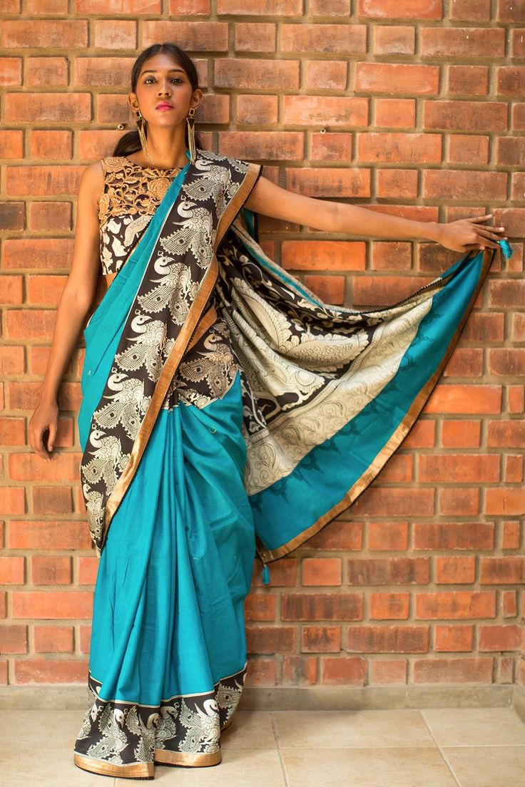Cool, stylish, comfortable, chic…these are some of the words which come to mind looking a this drape. The cotton to keep you cool and comfortable, the blue keeps you chic and stylish, the handpainted Kalamkari border keeps you earthy. We would say it ticks all the boxes with a flourish!Make this drape truly interesting by pairing with a black and white Kalamkari Blouse. Or pair with a never fail black blouse and yet maintain your chic quotient! #kalamkari #saree #india #blouse #houseofblouse