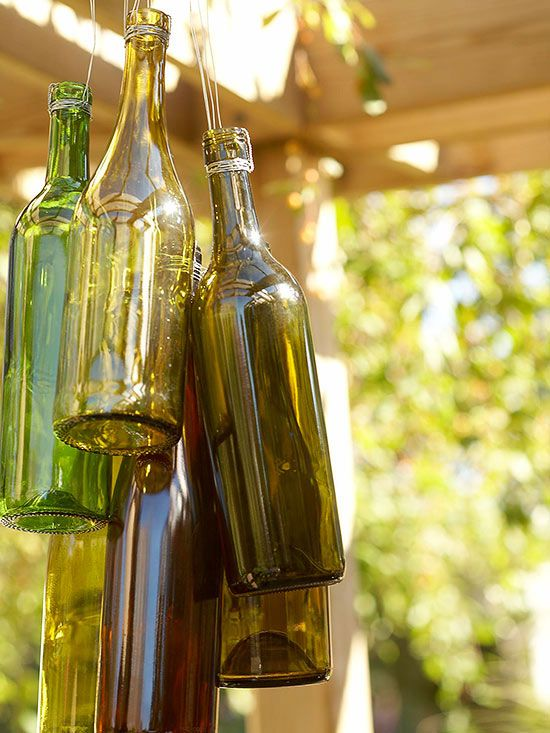 """DIY - """"chimes"""" made from wine bottles! More outdoor decorating projects: http://www.bhg.com/home-improvement/porch/outdoor-rooms/outdoor-decorating-projects/"""