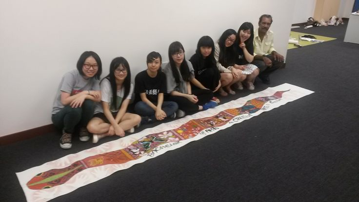 Some of my students with the Rainbow Serpent they painted.