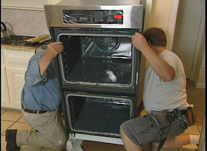 Learn how to remove and replace a built-in electric wall oven; includes details on modifying the opening and insuring a proper electrical supply