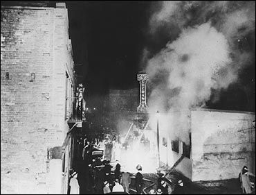 Smoke rises from the fire raging through the Cocoanut Grove nightclub. 1942