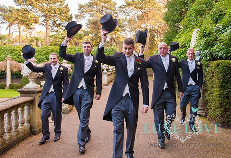 An Award Winning Wiltshire Wedding Photography sharing a selection of his private collection of wedding photographs for you to add to your Pin boards to help you create your own wedding ideas for Weddings in Wiltshire. This Pin Board theme is described as Classic Vintage, Vogue, Glamour, Fashion, Film, 1920's era, 1930's era. This photo showcases the Groomsmen in their Groomswear sporting Top Hats and Tails featuring The Groom, Father Of The Groom, Bestman and Ushers, Hats Off and Roses On