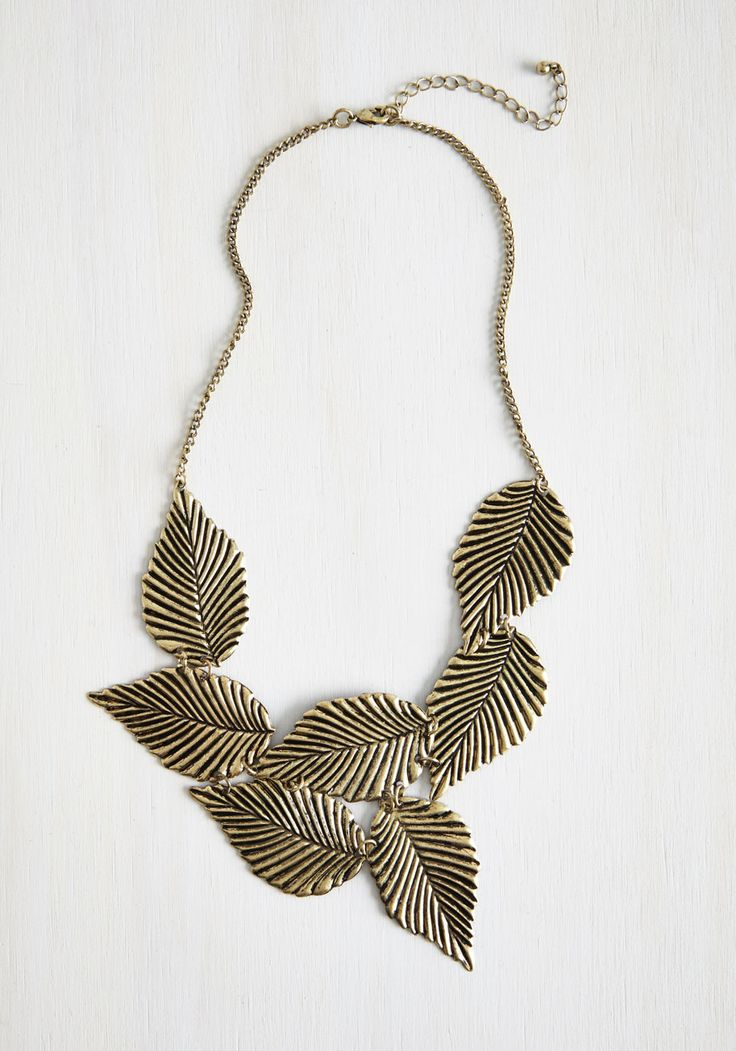 Leafing Town Necklace. When packing for a weekend getaway, choose your accessories wisely - you can get the most use out of very versatile items like this linked gold leaf necklace, as featured in People Style Watch! #gold #modcloth