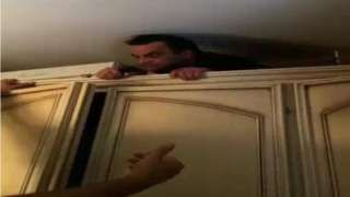 Image copyright                  POLIZIA DI STATO/AP                  Image caption                                      Police video shows Pelle's head peek out from the top of a large wardrobe                                A fugitive mafia boss has been found hiding in a secret compartment in his own home after five years on the run, Italian police say.