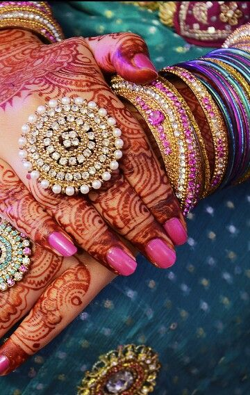 Bridal hand mehendi or henna designs. Bridal manicure. Statement ring.
