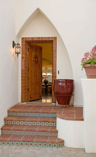 Santa Barbara Spanish style home. The tiles and wrought iron exterior lighting is beautiful!