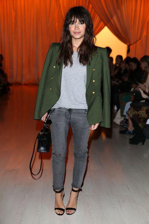 Miroslava Duma in an army green blazer + grey tee + grey skinny jeans + black ankle-strap heels