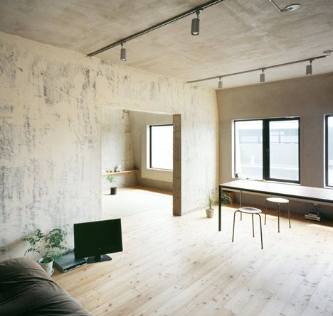Sliding doors between the rooms of the Setagaya Flat are made from larch plywood and could be mistaken for construction hoarding.