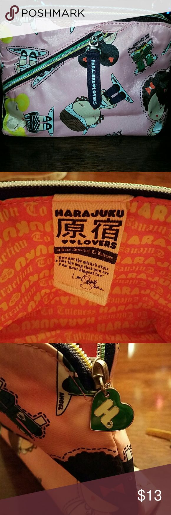 Hara juku lovers bag Polyester,  punk, satin feel.  Cute for all ages.  Make up or accessories bag.  Fun,  two tone zipper pocket on top and outside.  Measures as shown.  Machine washable.  No signs of wear,  inside or out. Harajuku Lovers Bags Cosmetic Bags & Cases