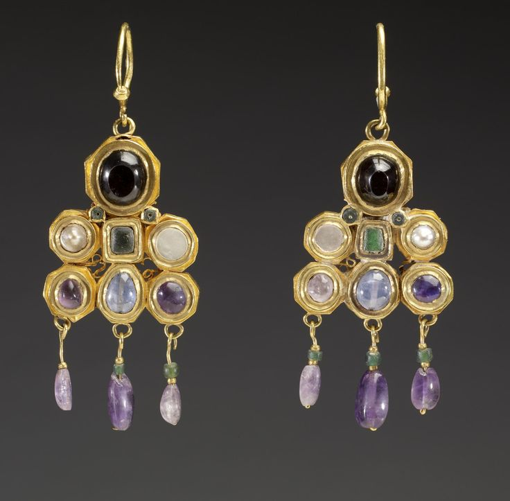 These dramatic, colorful earrings were most likely made in Constantinople, perhaps as an imperial gift to a Visigothic ruler of medieval Spain, where the earrings were found. The Visigoths, a migratory group that ultimately settled in Spain, had by the 6th century established trade and diplomatic contacts with the Byzantine court, whose jewelry they much admired. circa 600 (Early Medieval) gold, pearls, and semiprecious stones