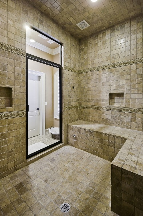 Spa Shower with Steam bath  http://CelticCustomHomes.com  This HUGE shower was done in all Noce Travertine, with Steam Shower built in as well as two shower heads.
