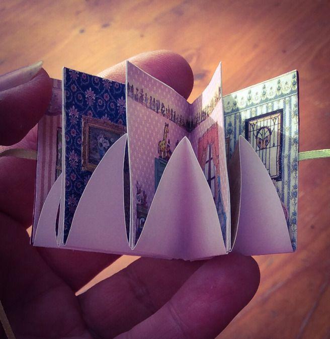 A little folding dollhouse book.