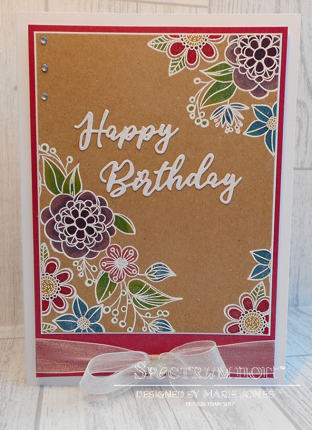 5x 7 card Designed by Marie Jones. Made using Spectrum Noir Colorista – Elements 1 stamp. Coloured with Spectrum Sparkle – Moonlight, Solar Red, Emerald Green, Fig, Blue Topaz & Crystal Clear Overlay. #crafterscompanion #spectrumnoir