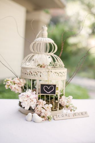 A birdcage centerpiece for a shabby chic style wedding.