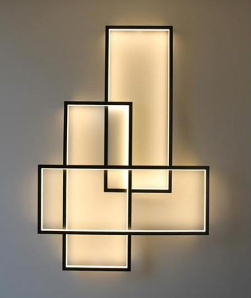 During the day, the TRIO LT Wall sconce is a decorative fixture.  At night, it is illuminated with 600 LED lights.  Several ways to produce the light and the desired ambiance:  The TRIO can be set to automatically change the intensity of the light frame by simply using the infrared remote control. (PSCBath)
