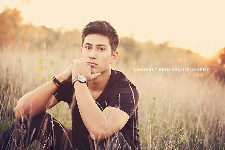 senior pictures - like the long grass and slightly faded coloring