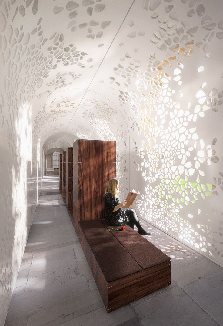 Laser cut screen. The delicate skin of the lodge is perforated with a pattern inspired by self-replicating botanical cells and the design picks up a number of other key references to the architecture of the college – from the stuccoed white ceilings and timber bookcases of the library to the secret walled gardens at the west of the college.